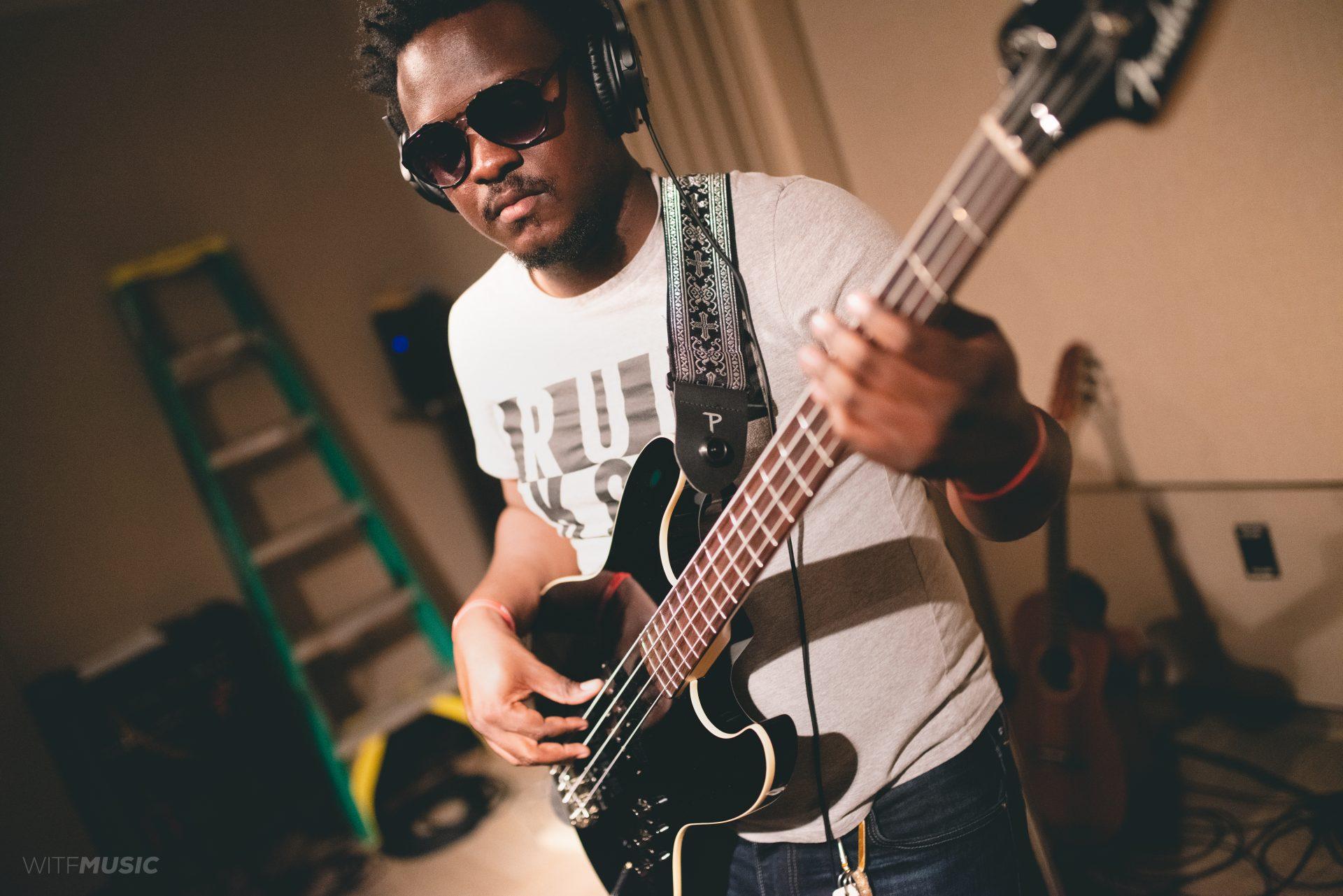 Emmaneul Nsingani playing bass.