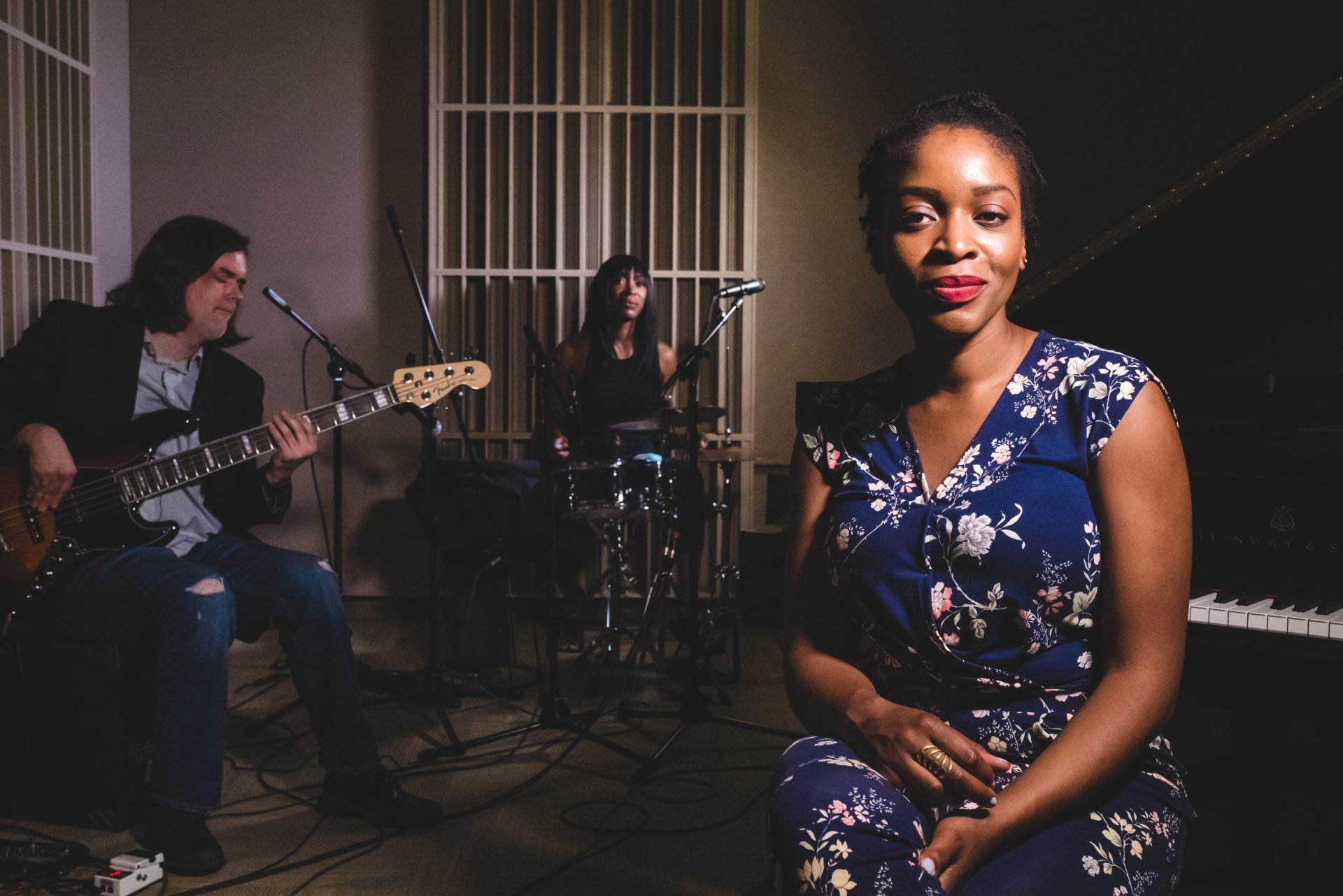 Joy Ike sitting with her band.