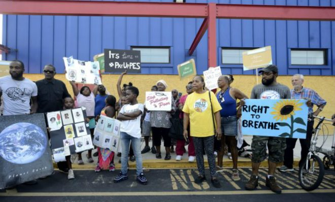 Neighbors and activists with Philly Thrive protest  Tuesday outside Preparatory Charter School ahead of the first meeting of the Philadelphia Energy Solutions refinery advisory group.