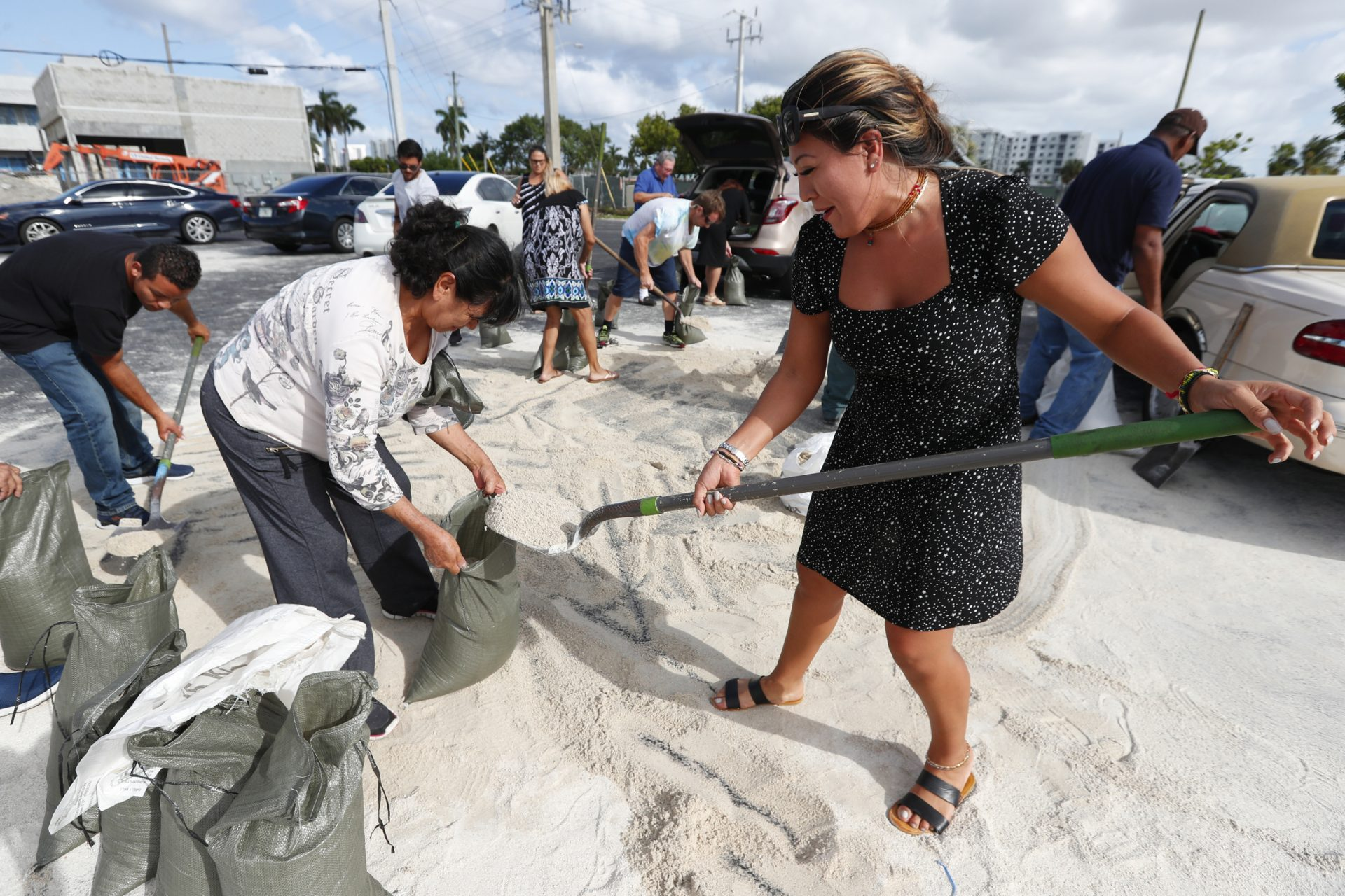 Georgia Bernard, right, and Ana Perez are among residents filling sandbags to take home in preparation for Hurricane Dorian, Friday, Aug. 30, 2019, in Hallandale Beach, Fla., as the town allowed residents to fill up sandbags until they ran out. All of Florida is under a state of emergency and authorities are urging residents to stockpile a week's worth of food and supplies as Hurricane Dorian gathers strength and aims to slam the state as soon as Monday as a Category 4 storm.