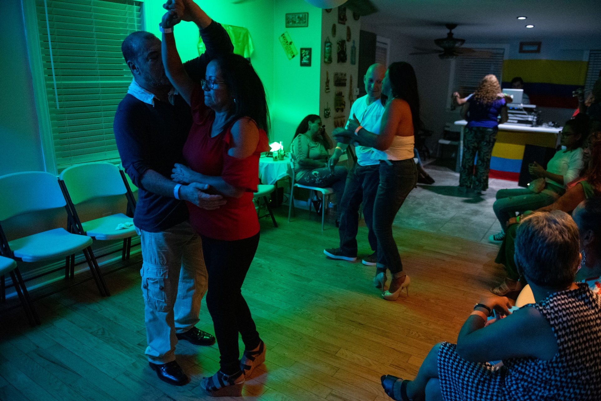 Guests dance in a viejoteca held in an Oxford Circle home on Sunday, September 15, 2019.