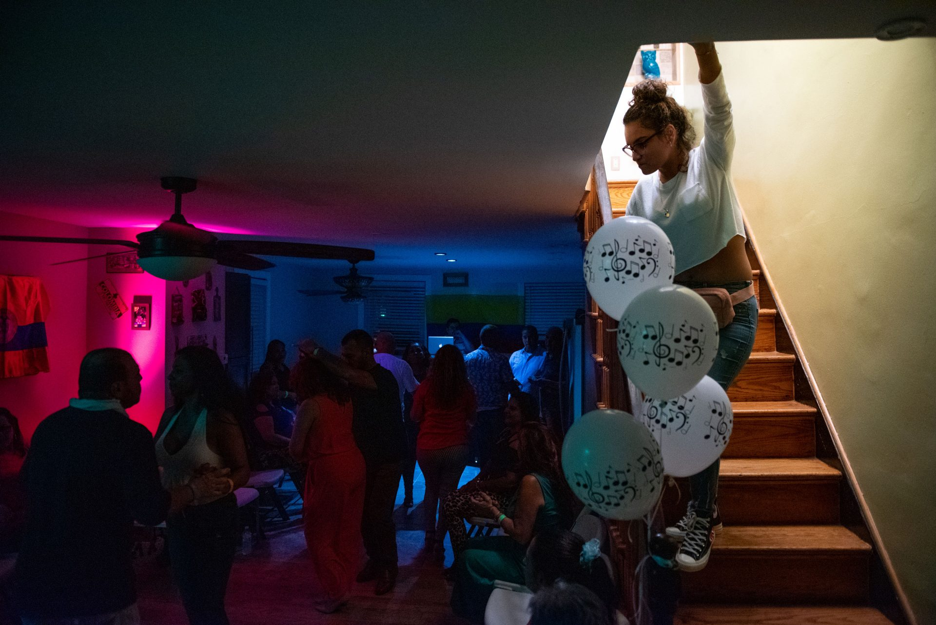 Sandra Colon laughs while dancing in the living room of her Oxford Circle home on Sunday, September 15, 2019. Colon regularly turns her home into a viejoteca (a dance party for older adults) after one restaurant in Philadelphia that hosted them closed down.