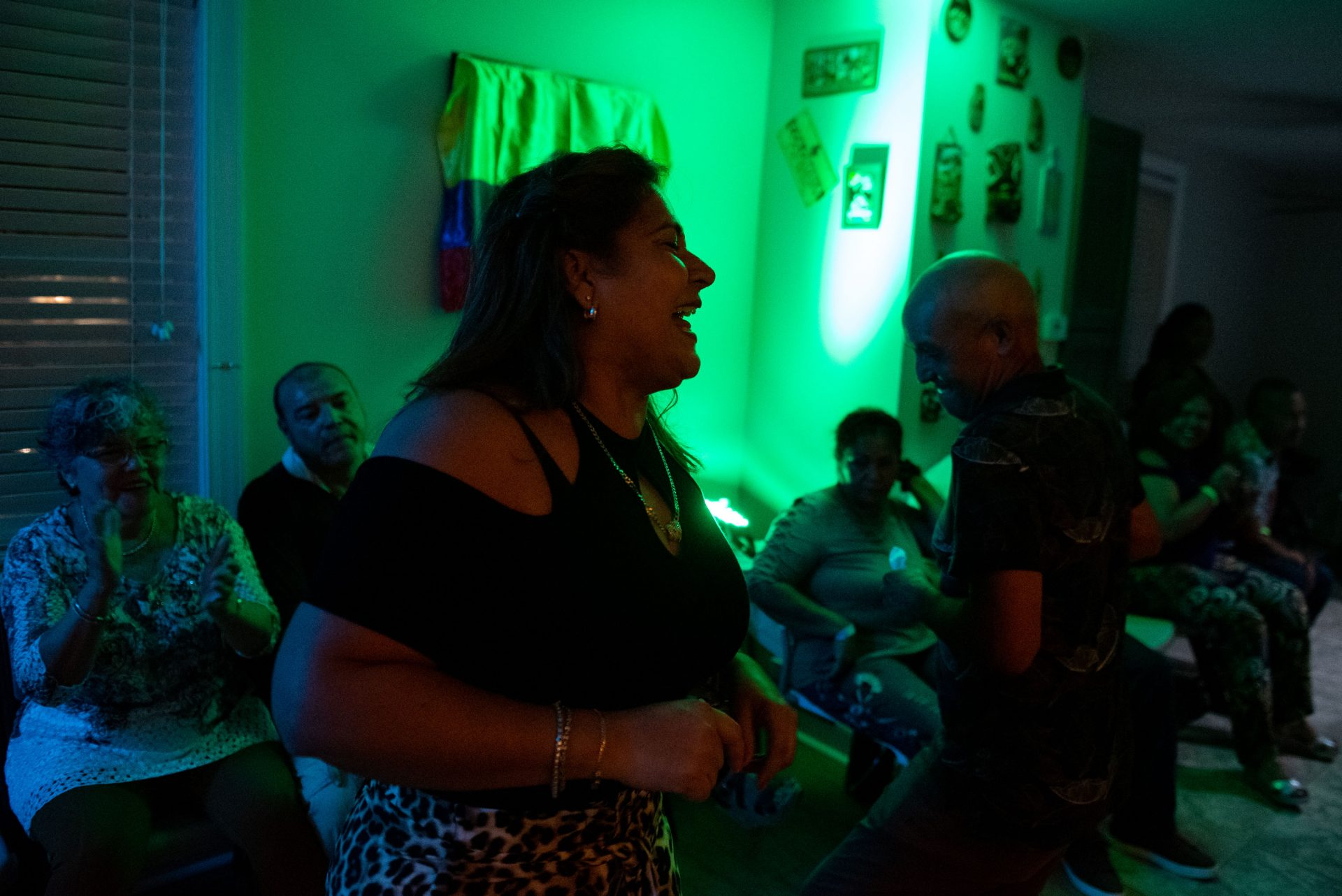 Einar Victoria is seen dancing with Liliana Acero through the front entrance of an Oxford Circle home-turned-viejoteca on Sunday, September 15, 2019.