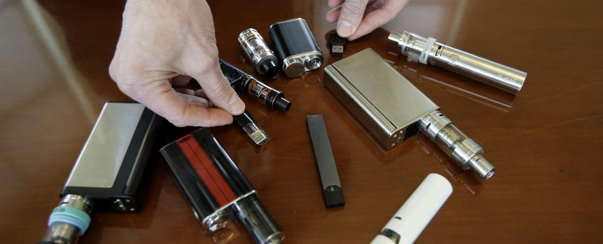 FILE PHOTO: In this Tuesday, April 10, 2018 file photo Marshfield High School Principle Robert Keuther displays vapes that were confiscated from students in Marshfield, Mass.