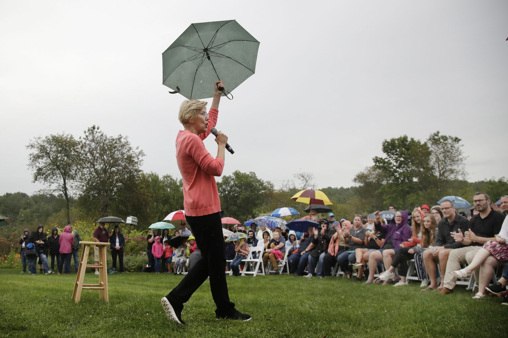 Democratic presidential candidate Sen. Elizabeth Warren, D-Mass., gestures with an umbrella as she speaks at a campaign event, Monday, Sept. 2, 2019, in Hampton Falls, N.H.