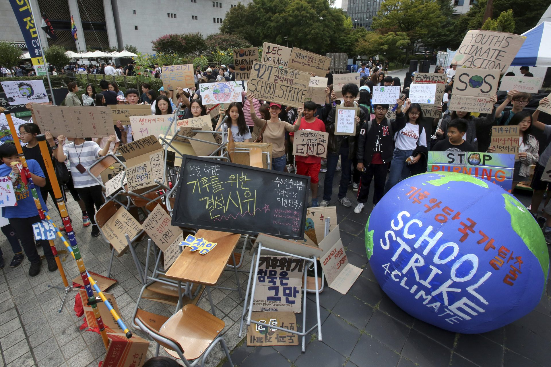 Students stage a rally demanding the escape from the climate crisis in Seoul, South Korea, Friday, Sept. 27, 2019. Hundreds of students boycotted classes and gathered to demand world leaders' action to stop climate change.