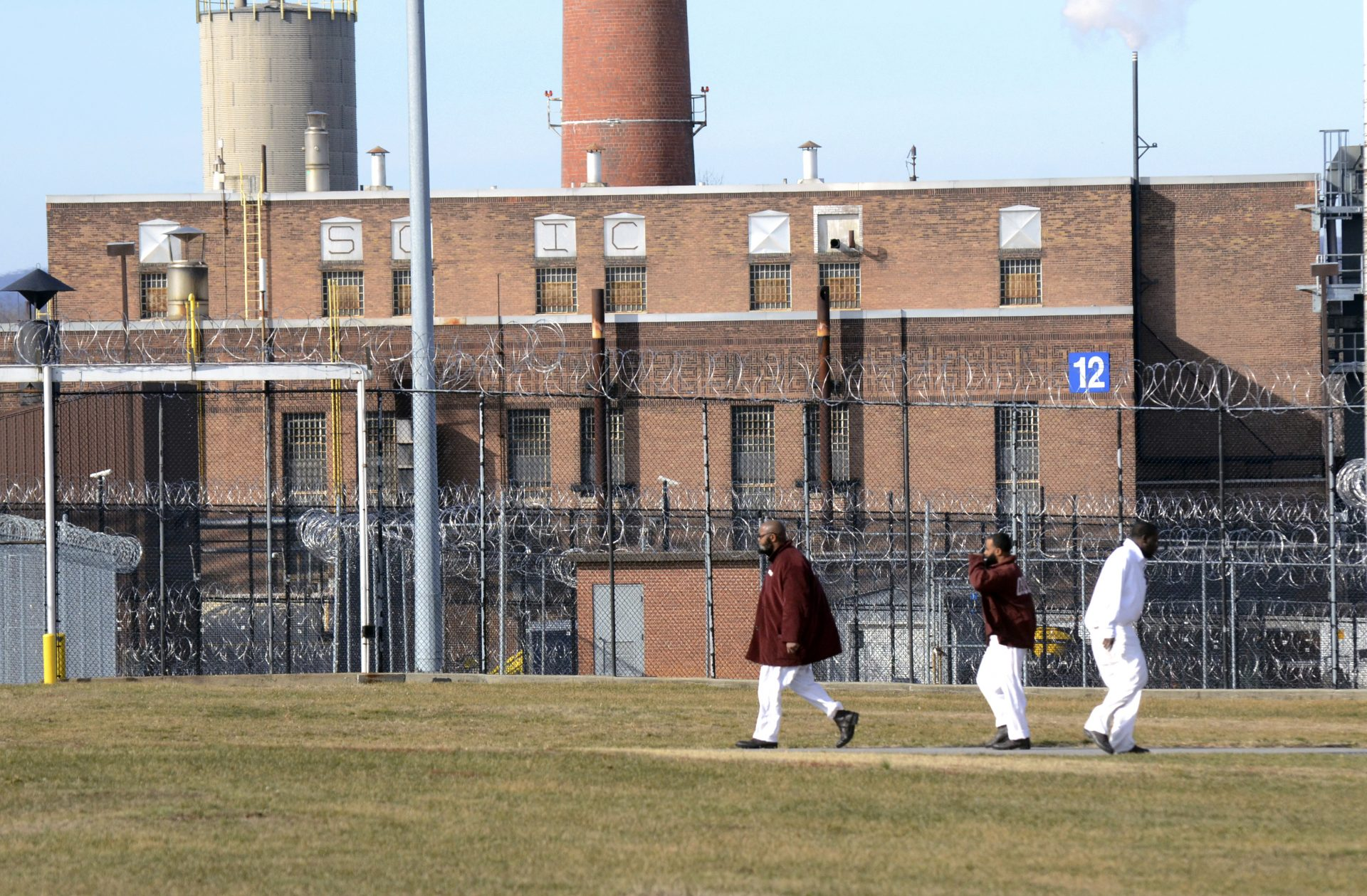 Inmates walk across a yard at the State Correctional Institution at Camp Hill, Pennsylvania, Friday, Jan. 13, 2017, in Camp Hill, Pa.