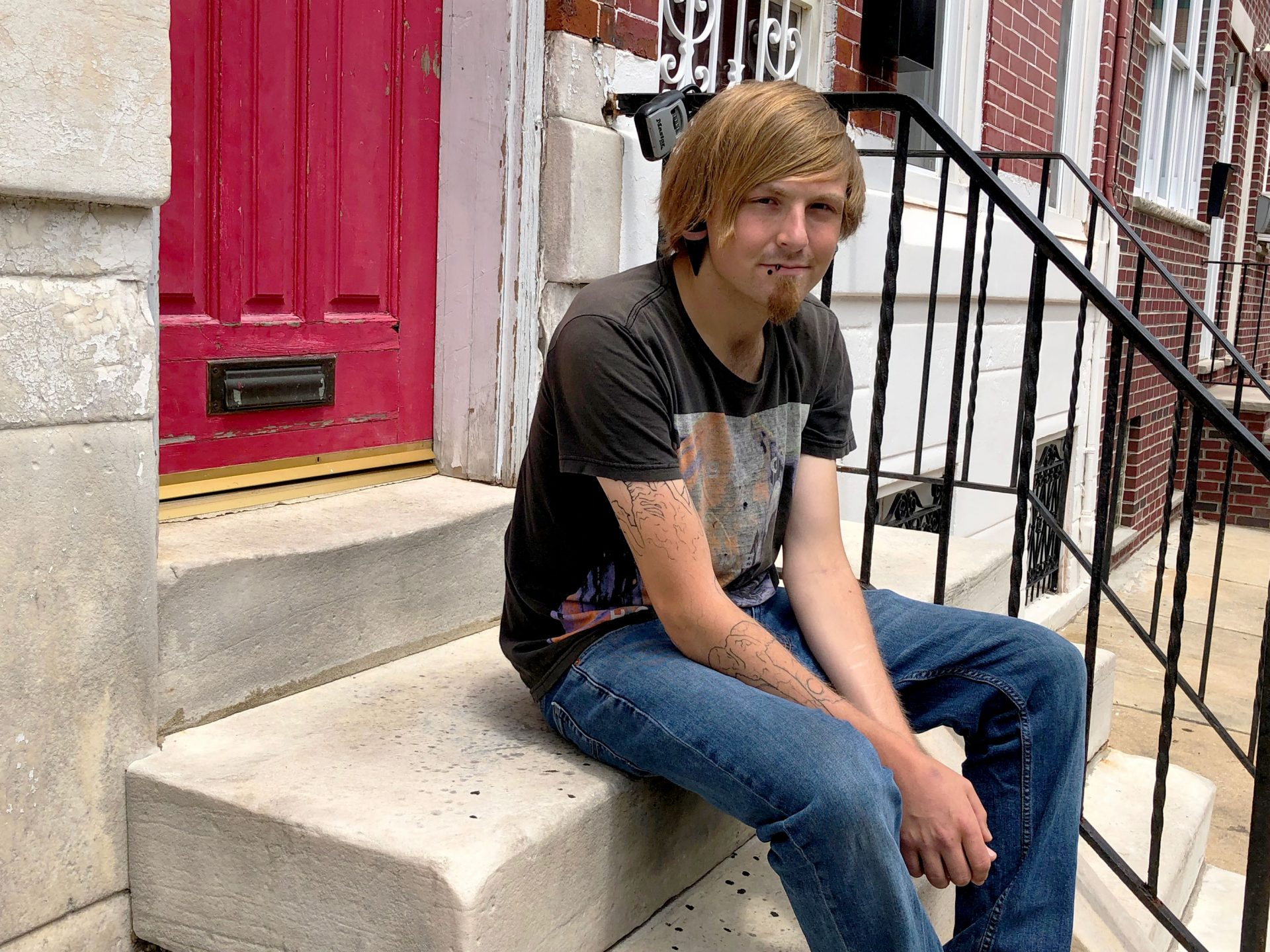 Brad Wienczkowski outside his recovery house in South Philly in June. Wienczkowski overdosed after being kicked out of treatment for smoking a cigarette.