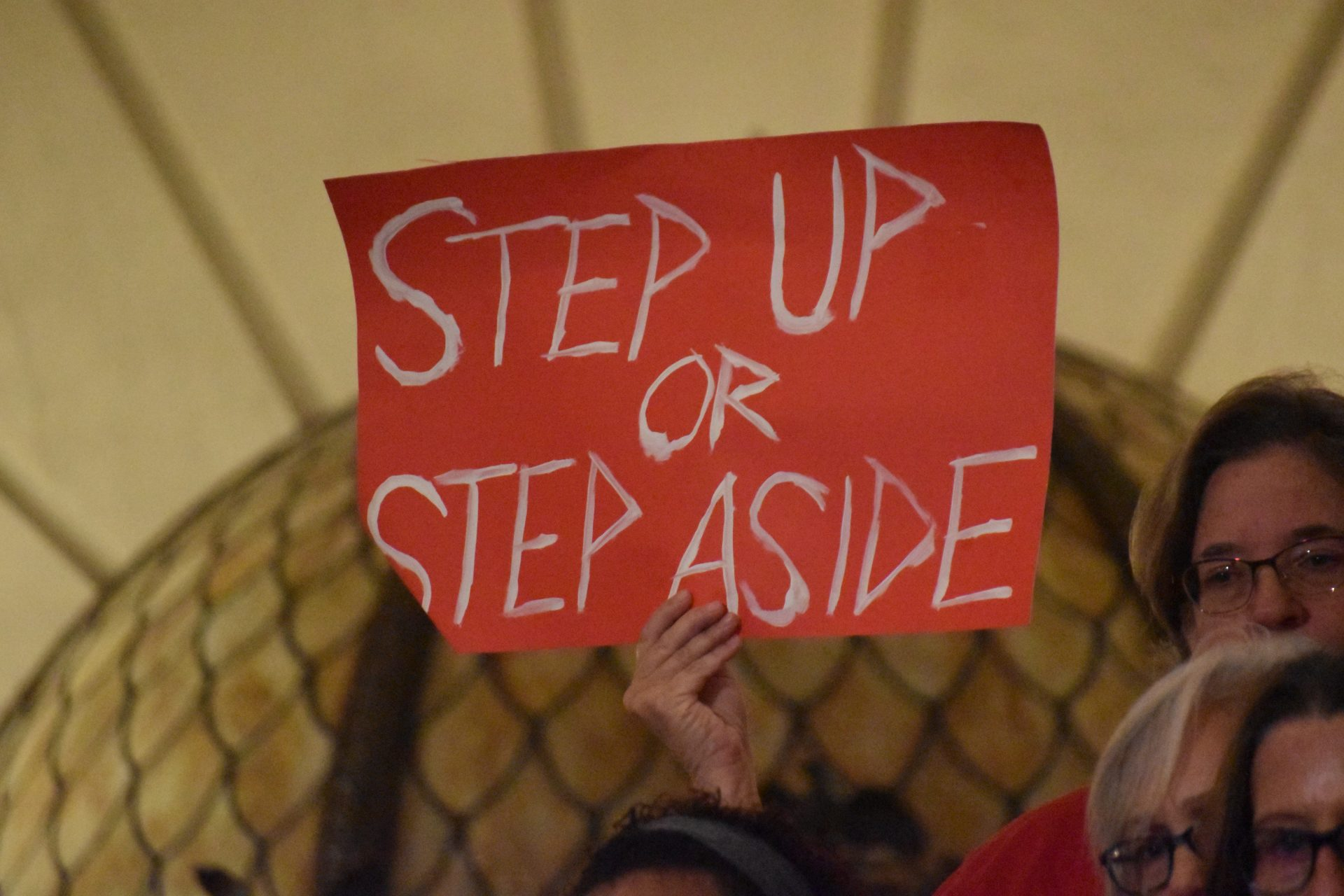 "A sign reads ""Step Up or Step Aside"" at a rally in the state Capitol on Sept. 17, 2019. Volunteers with Moms Demand Action gathered in the Capitol to support extreme risk protection orders."