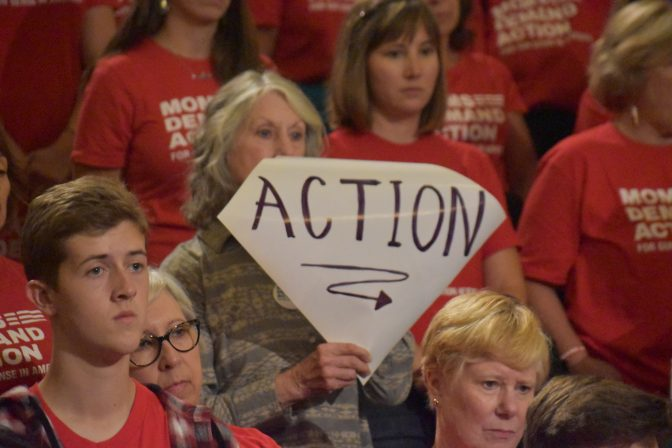 "A sign reads ""ACTION"" during a rally in support of extreme risk protection orders in Harrisburg on Sept. 17, 2019 in the Pennsylvania Capitol."
