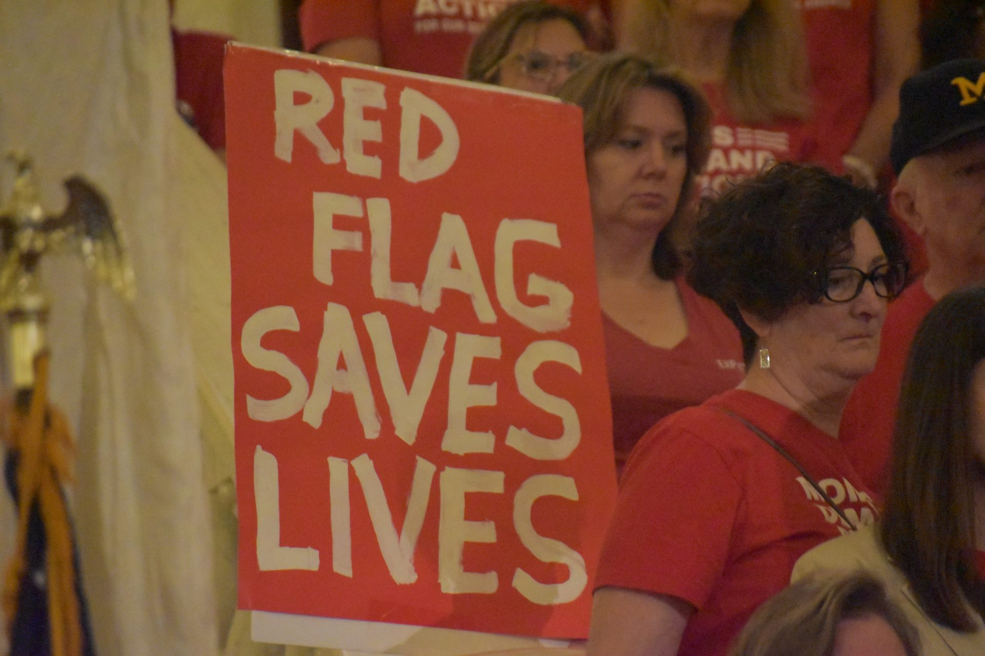 "A demonstrator with the Pennsylvania chapter of Moms Demand Action holds a sign that reads ""Red Flag Saves Lives"" during a rally on Sept. 17, 2019, in the Pennsylvania state Capitol in Harrisburg."