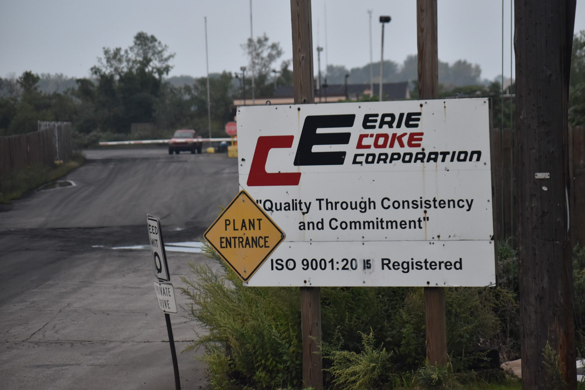 A sign for the entrance of Erie Coke.