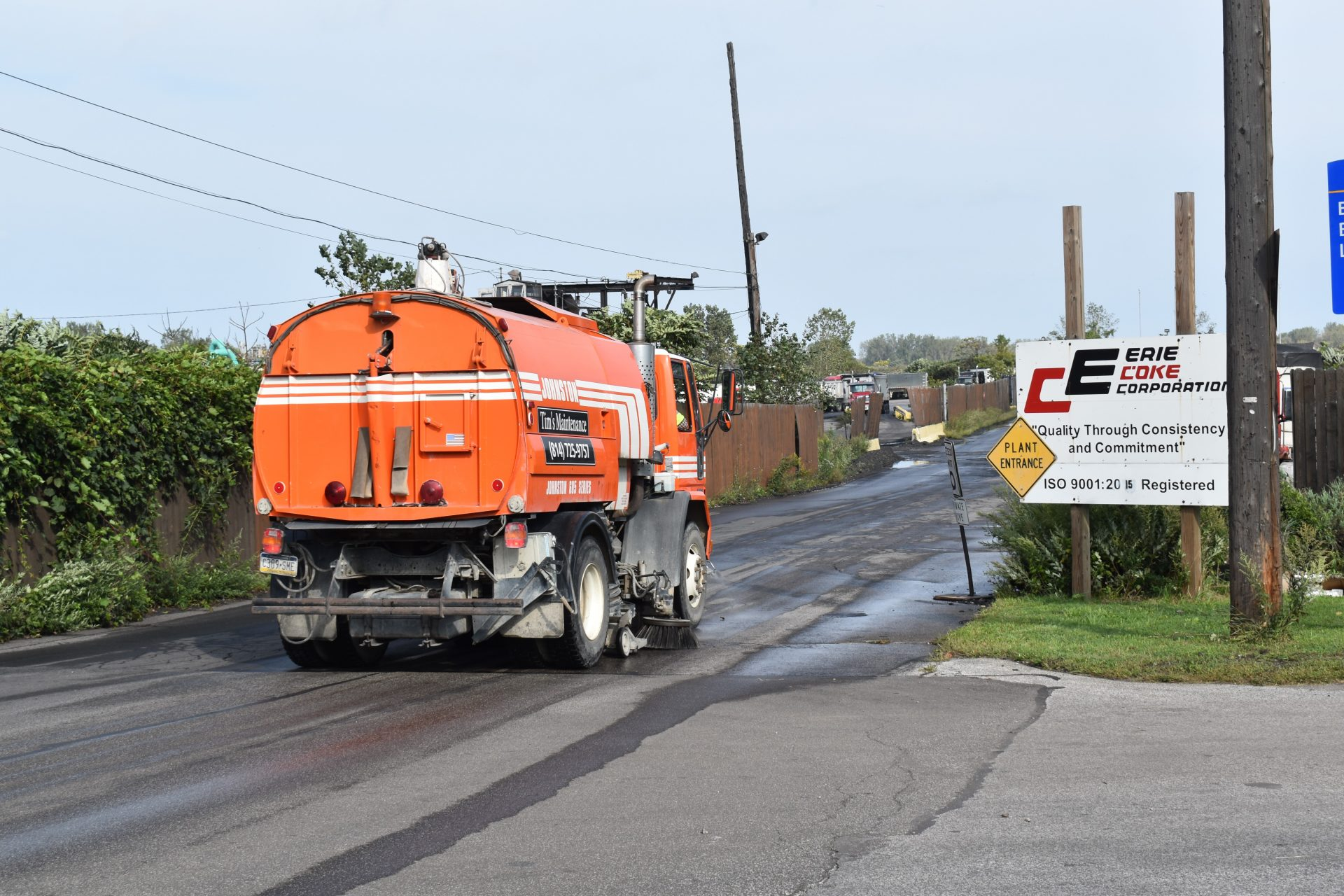 A vehicle cleans the road leading into Erie Coke on Sept. 13, 2019.