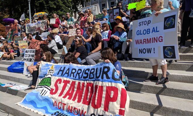 Demonstrators gather on the steps of the state capitol in Harrisburg to demand action on climate change on Friday, September 20, 2019.