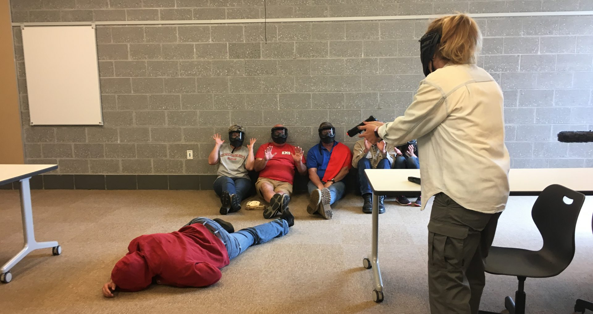 "Teachers practice responding to active shooter scenarios at Wadsworth High School in Ohio. Cerino tells the trainees pretending to be students, ""Beg for your life."""