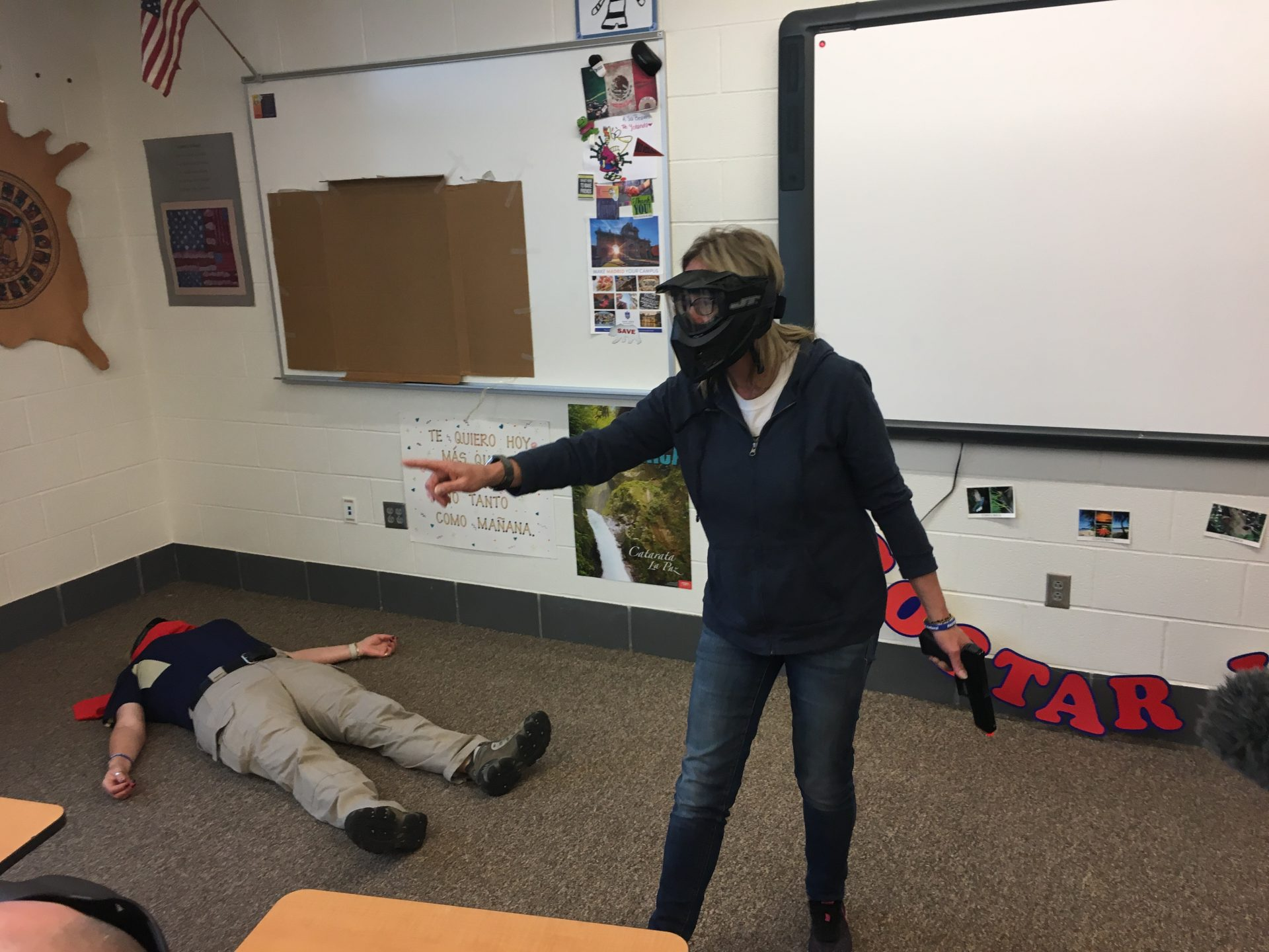Angie directs students during a shooting simulation.