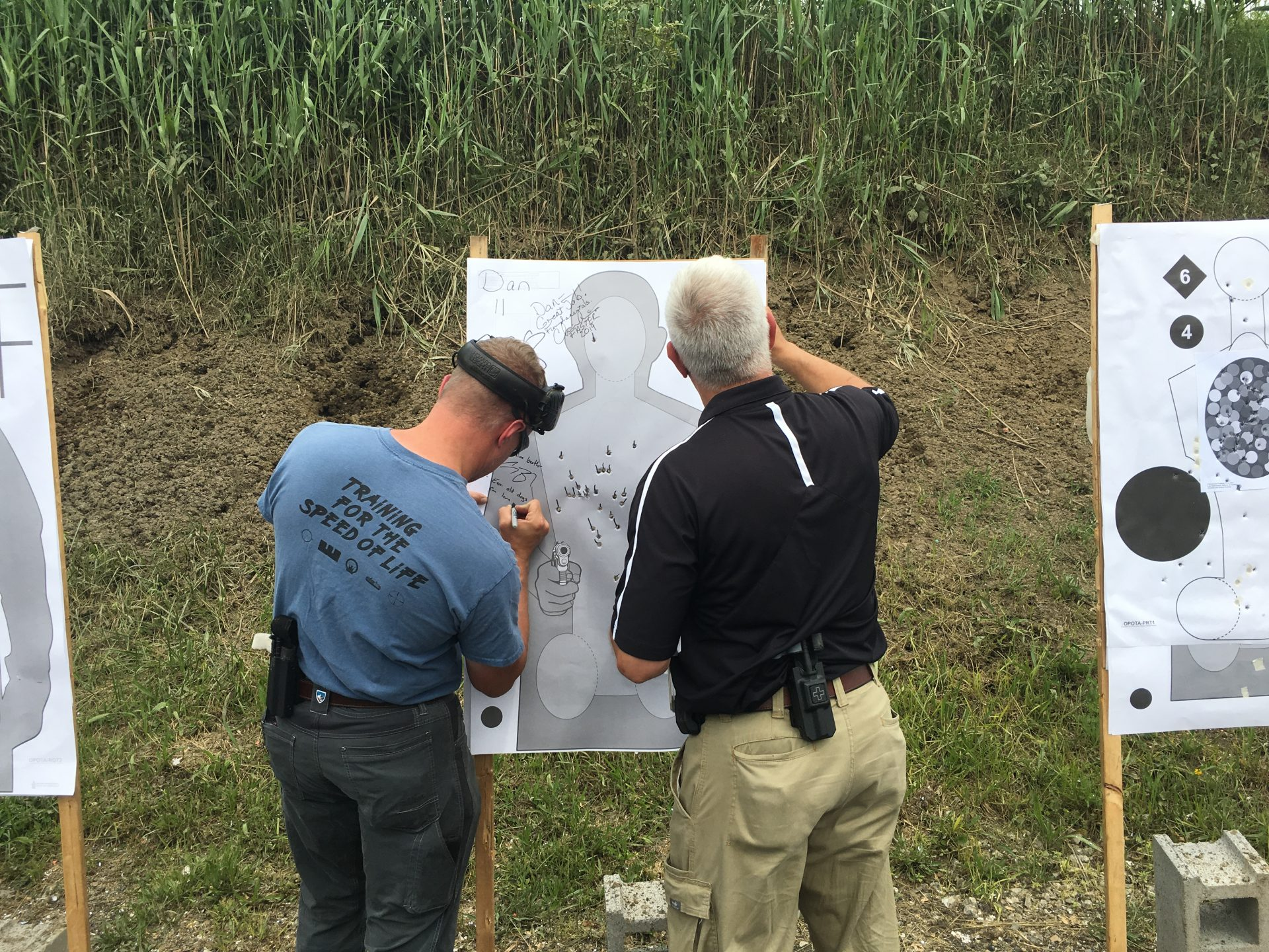 FASTER's Andrew Blubaugh and Joe Eaton score the targets of teachers hoping to pass their training.