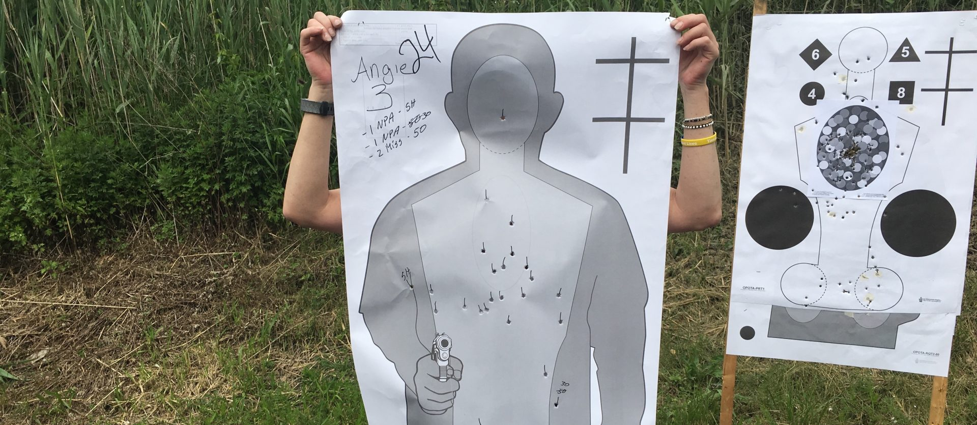 """Angie, a 5th grade teacher in the training program, uses one of her targets to shield her identity. """"I never myself had a gun, didn't grow up around them, so it wasn't in my life. But as I became a teacher and having the kids that are in my classroom and knowing that if there is a kind of threat, I'd want to protect them,"""" she said."""