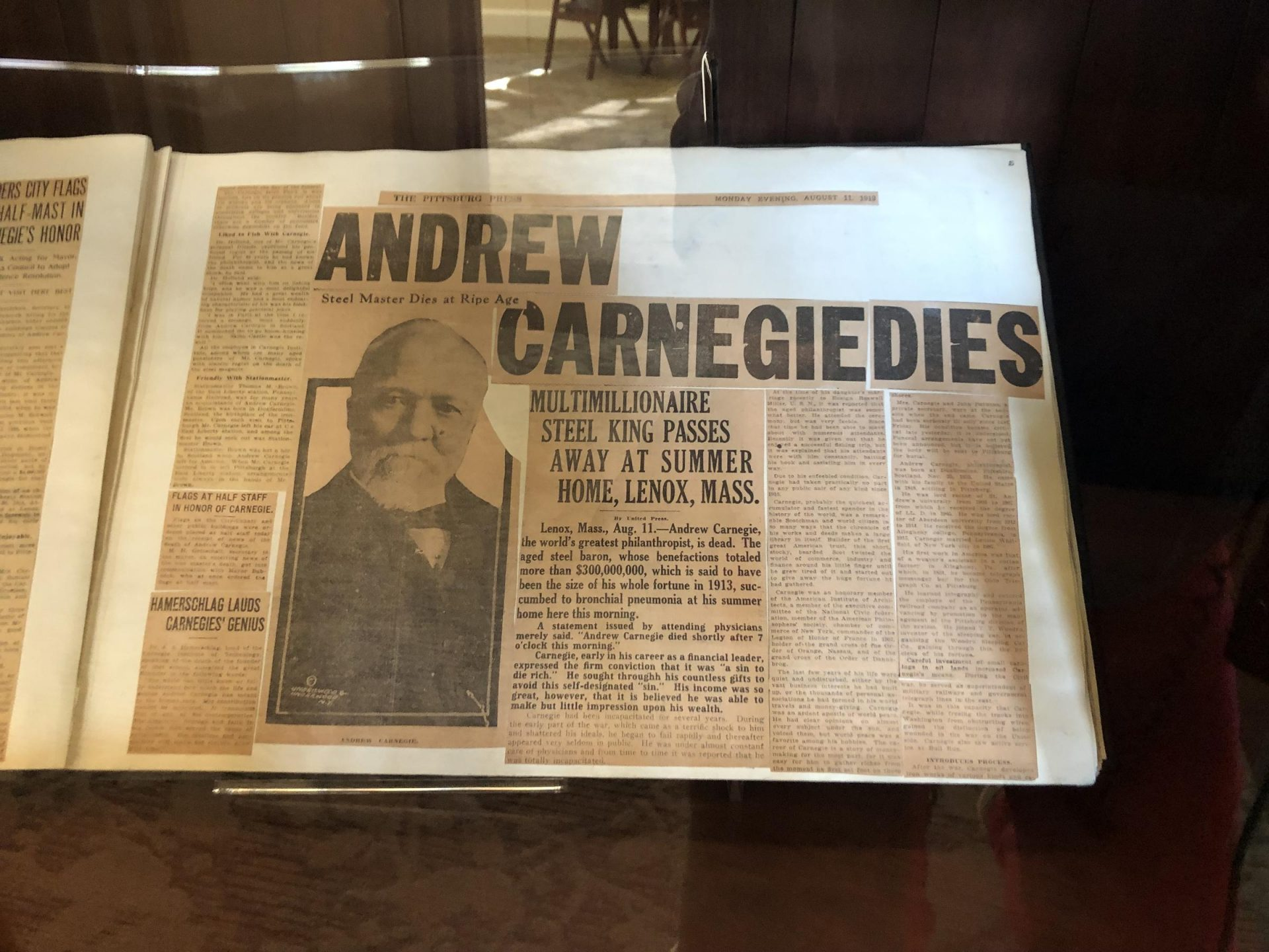 A display case in the Carnegie Library of Pittsburgh's main branch has the newspaper article announcing the industrialist's death.