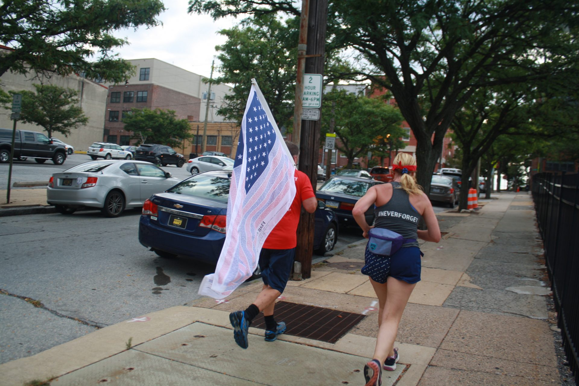 Runners head through downtown Wilmington on their way from the Pentagon to Ground Zero in New York City as part of the 243-mile 9/11 Promise Run.