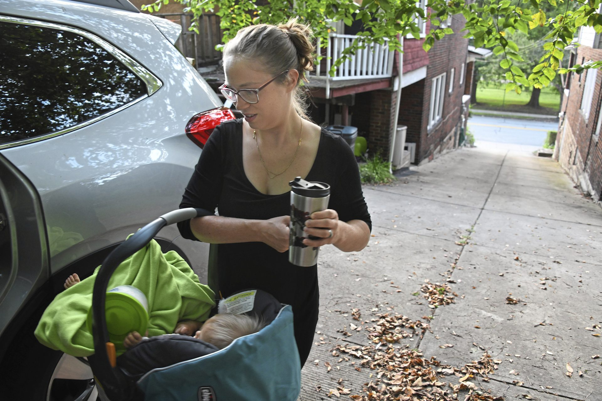 Lauren Narbey, a certified nurse midwife and a certified nurse practitioner, carries her daughter, 1-year-old Eleanor, toward the car, Friday, Sept. 6, 2019, in the Highland Park neighborhood of Pittsburgh.