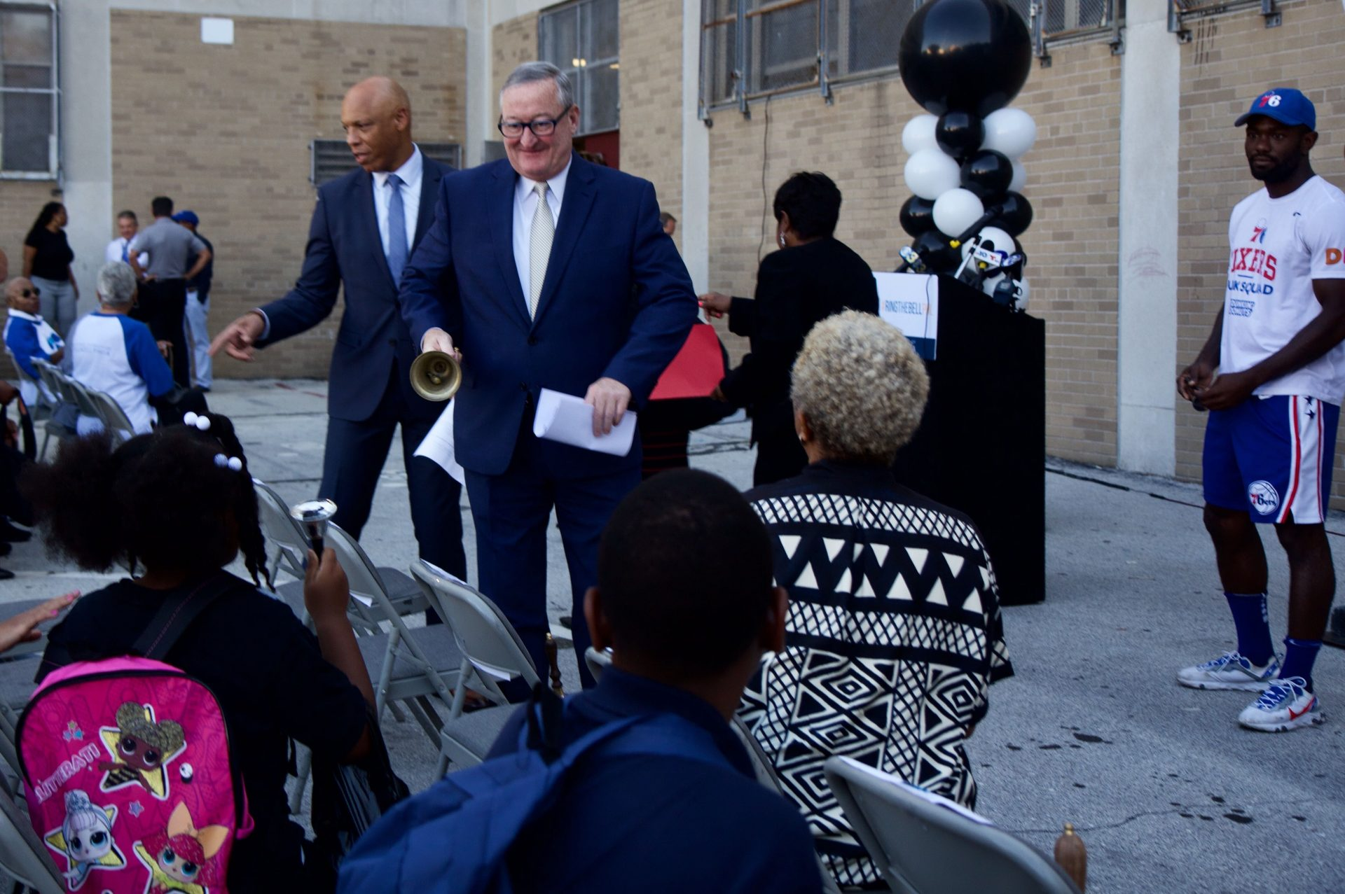 Philadelphia superintendent William Hite and Mayor Jim Kenney ring bells with students at Robert Morris Elementary School.