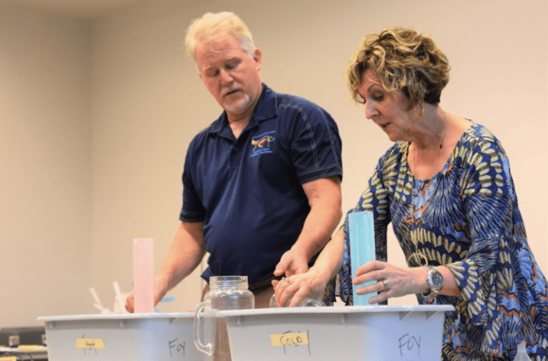 Science teacher Leigh Foy (right) couldn't find climate education materials so she and her husband, chemistry professor Greg Foy (left) designed their own.