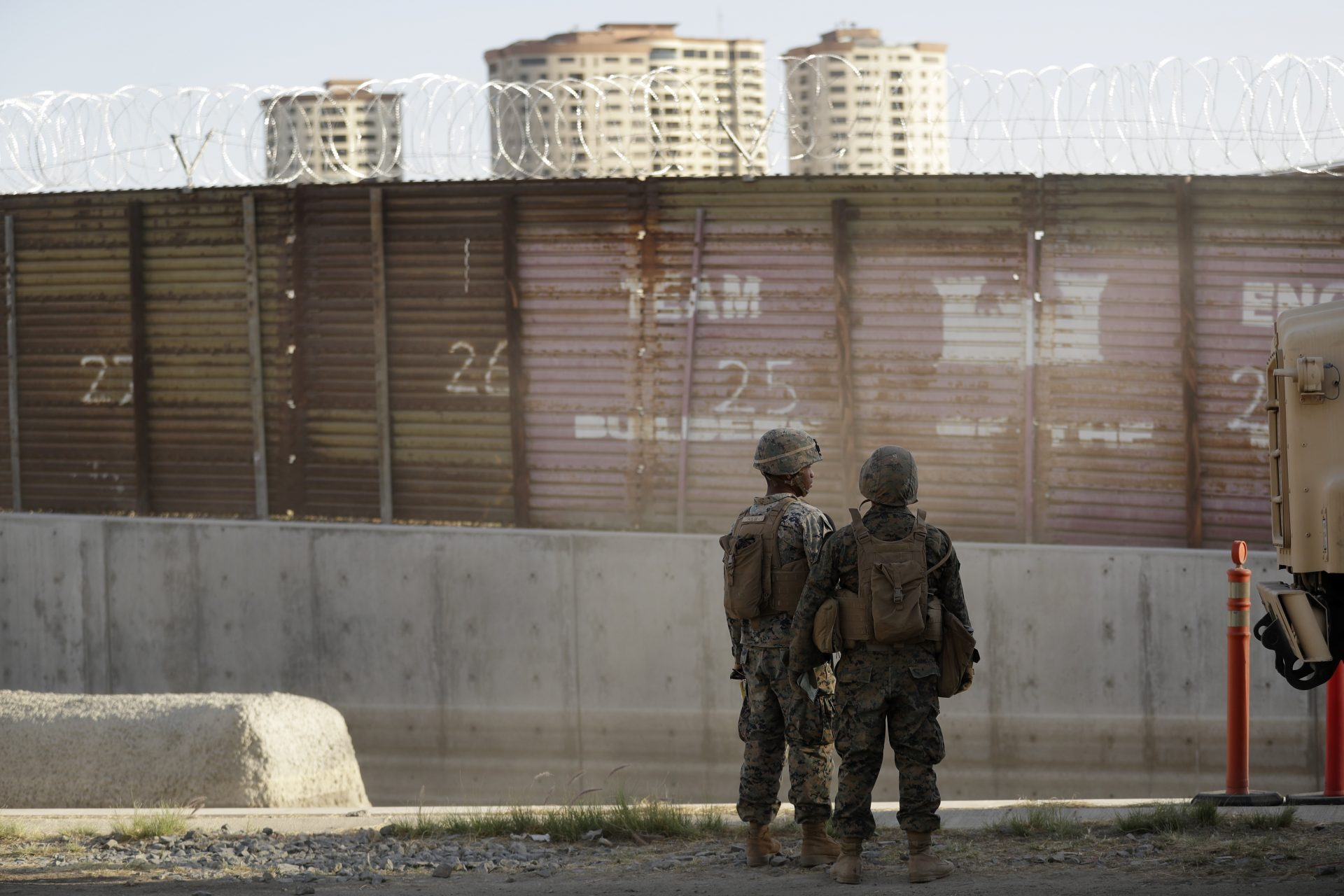 FILE PHOTO: Marines look on during work to fortify the border structure that separates Tijuana, Mexico, behind, and San Diego, near the San Ysidro Port of Entry, Friday, Nov. 9, 2018, in San Diego.