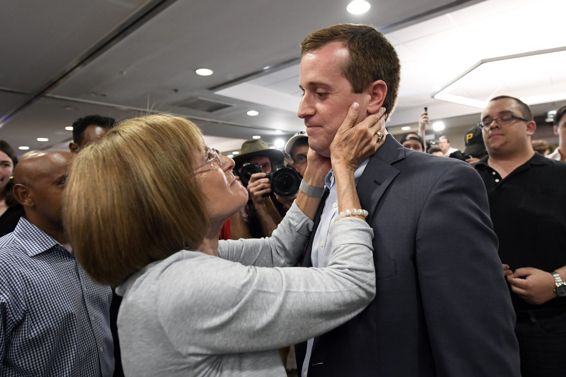 Mattye Silverman of Charlotte, consoles Democrat Dan McCready after he lost a special election for United States Congress in North Carolina's 9th Congressional District to Republican, Dan Bishop, Tuesday, Sept. 10, 2019, in Charlotte, N.C.