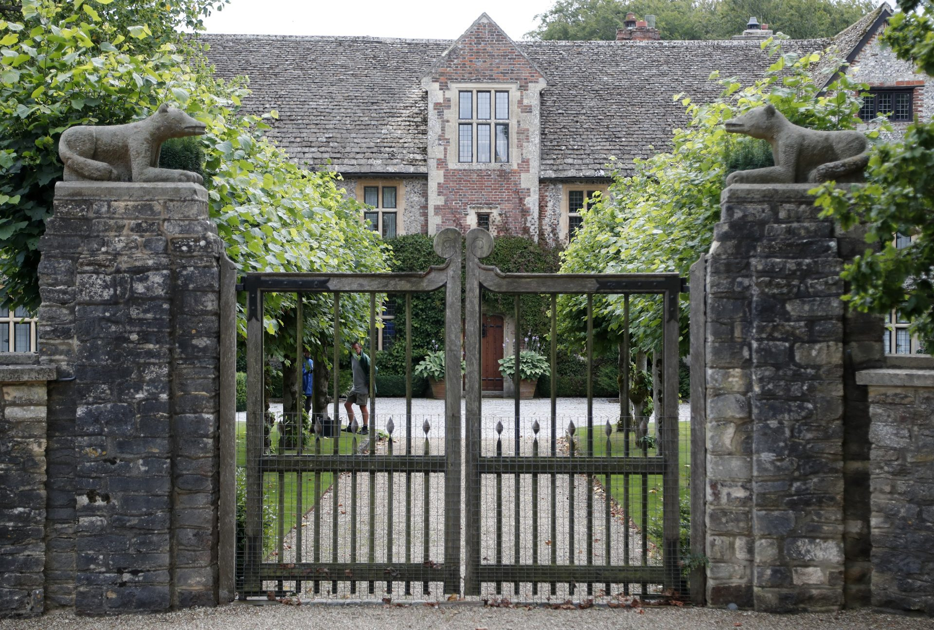 A gate protects the entrance of the Rooksnest estate near Lambourn, England, Tuesday, Aug. 6, 2019. The manor is the domain of Theresa Sackler, widow of one of Purdue Pharma's founders and, until 2018, a member of the company's board of directors. A complex web of companies and trusts are controlled by the family, and an examination reveals links between far-flung holdings, far removed from the opioid manufacturer's headquarters in Stamford, Conn.
