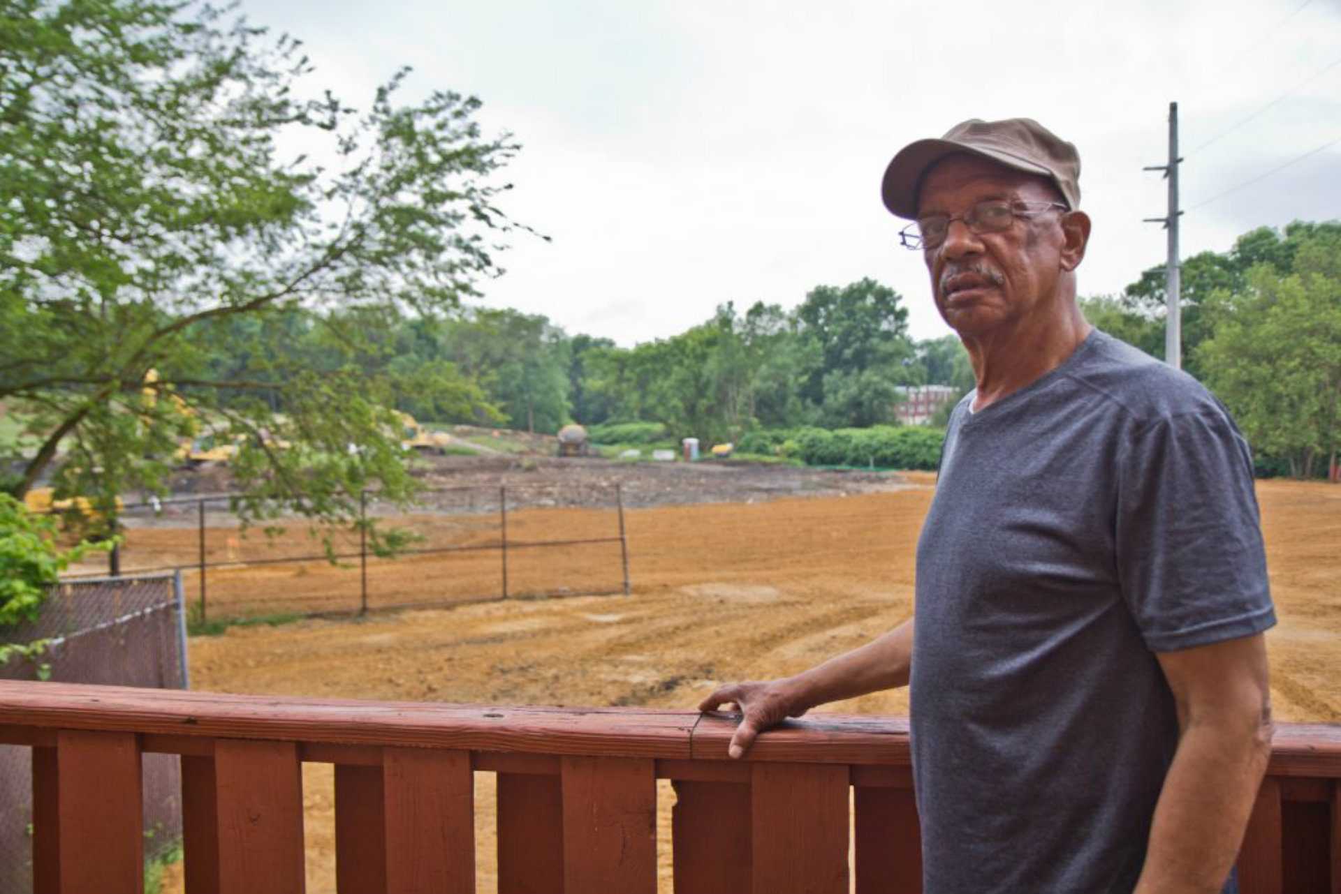 Leo Brudnrage's deck overlooks the efforts at the Eastwick Superfund landfill site. (Kimberly Paynter/WHYY)
