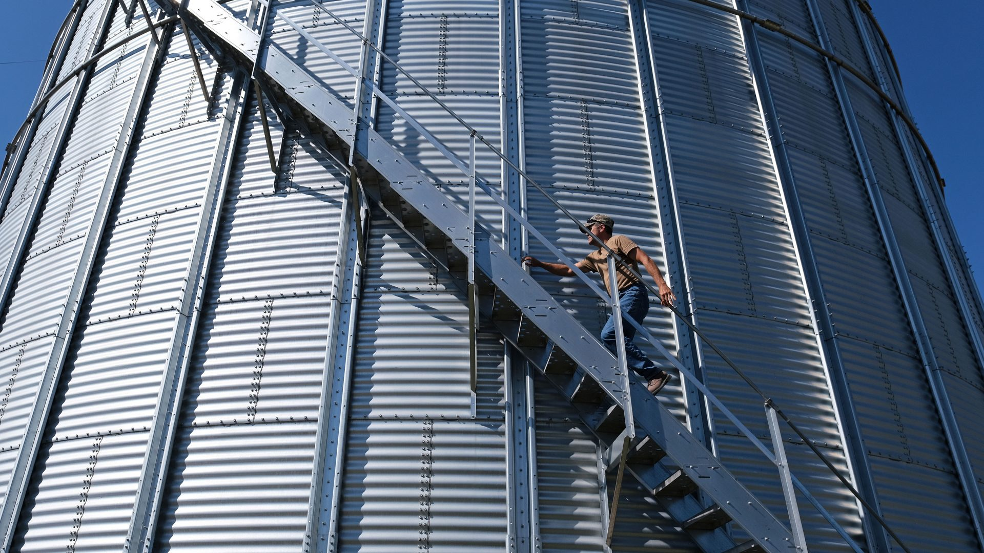 Grain farmer Don Cairns walks to the top of a grain silo Sept. 25, 2019, at Cairns Family Farm in Sadsbury Township, Pennsylvania.