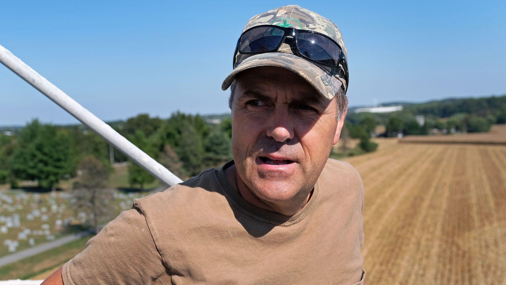 Grain farmer Don Cairns looks out over land he farms while atop a grain silo Sept. 25, 2019, at Cairns Family Farm in Sadsbury Township, Pennsylvania.