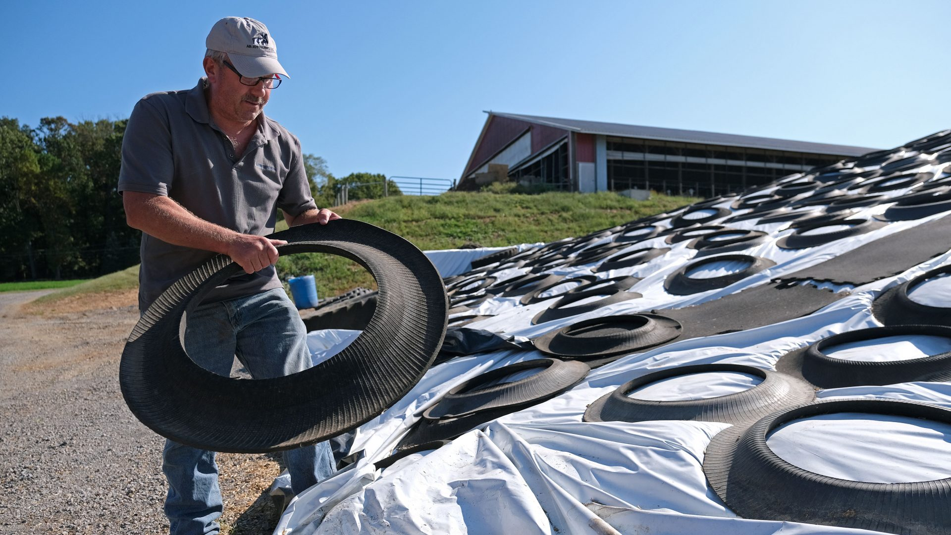 Dairy farmer Duane Hershey covers a pile of bedding for cows converted from cow waste and filtered and converted in an effort to reuse materials Sept. 25, 2019, at Ar-Joy Farms in West Fallowfield Township, Pennsylvania.