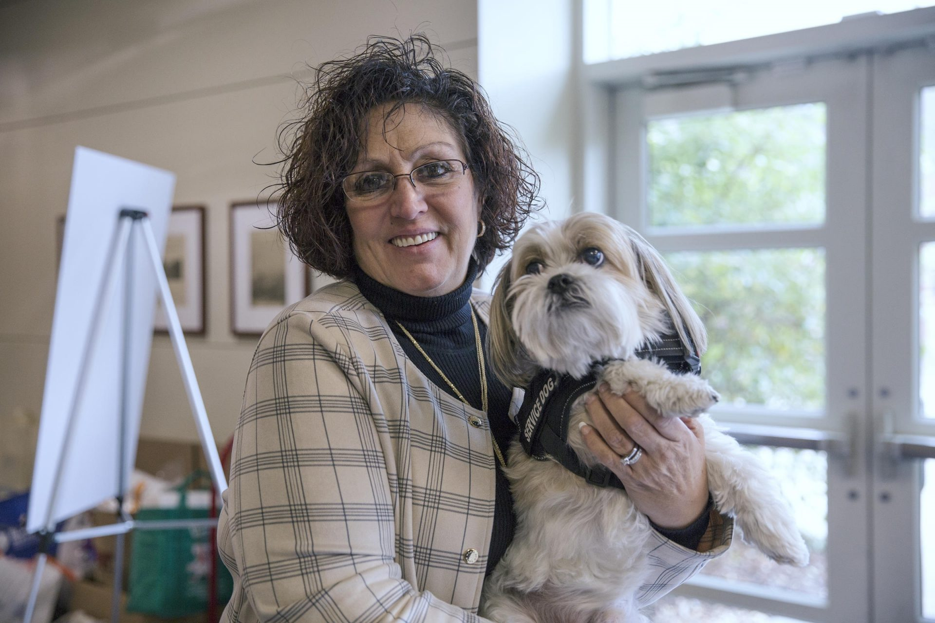 Jane Guerino, a survivor of sex trafficking, is with her service dog, Bailey. She says the public needs to recognize that human trafficking is happening across the state and beyond.