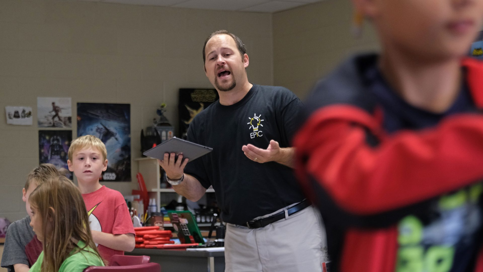 Discovery teacher Matt Derr instructs students as they work with a tornado simulation augmented reality program on smartphones Sept. 26, 2019, at Whitfield Elementary School in Spring Township, Berks County.