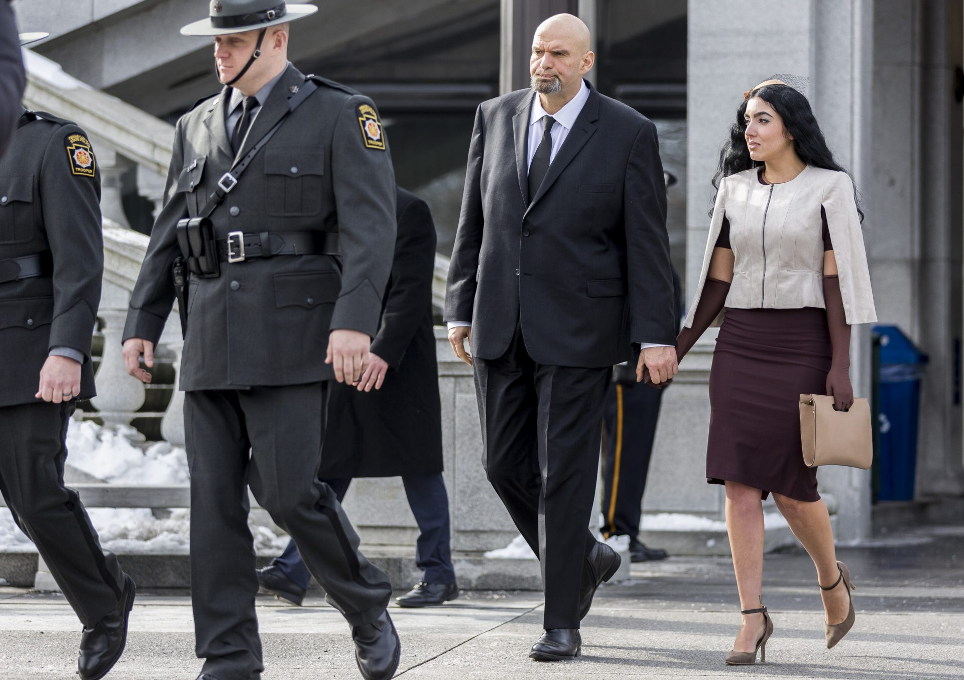 Pa. Lt. Gov. John Fetterman and his wife Gisele make their way to the stage before the inauguration of Pa. Gov. Tom Wolf held outside the Capitol East Wing on Jan. 15, 2019.