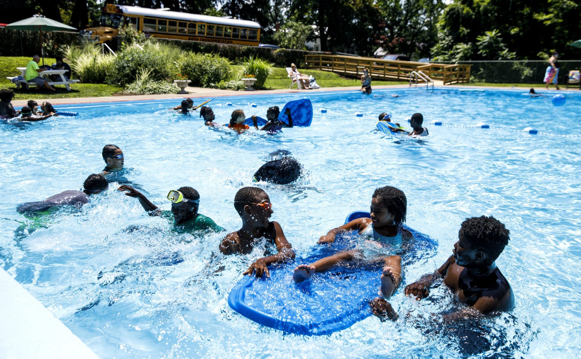 Students from Harrisburg's Rowland Academy swim in the pool. The swimming pool at the lieutentant governor's residence at Fort Indiantown Gap is open to groups in a program being overseen by Gisele Fetterman, second lady of Pennsylvania, to teach water safety and offer exposure to swimming. July 24, 2019.