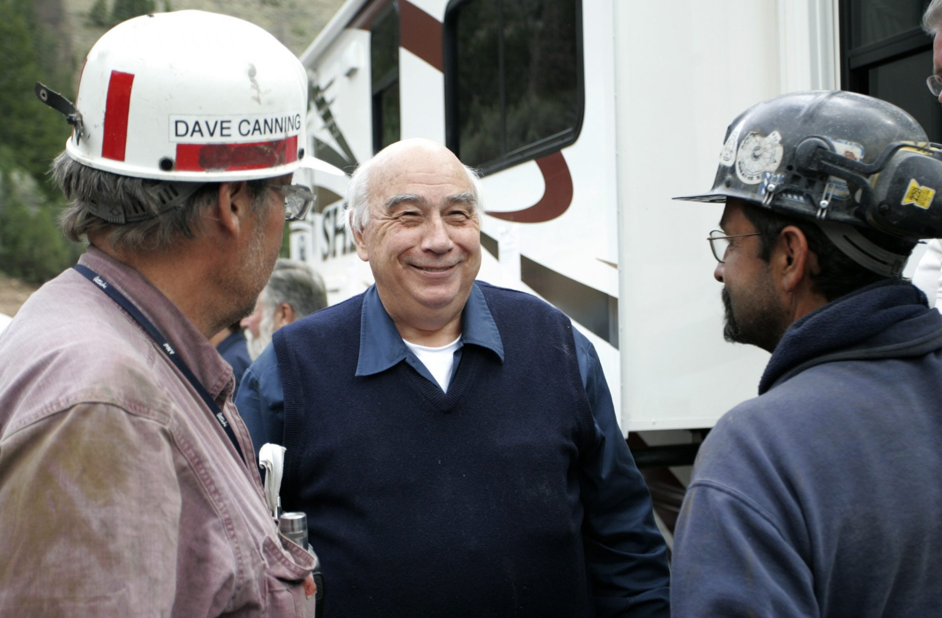 FILE PHOTO: In an Aug, 26, 2007 file photo, Robert Murray, center, chief executive of Murray Energy Corp., smiles while talking to Dave Canning, left, and Mike Glassom, right, two miners in charge of drilling bore holes into the Crandall Canyon M before a news conference northwest of Huntington, Utah.