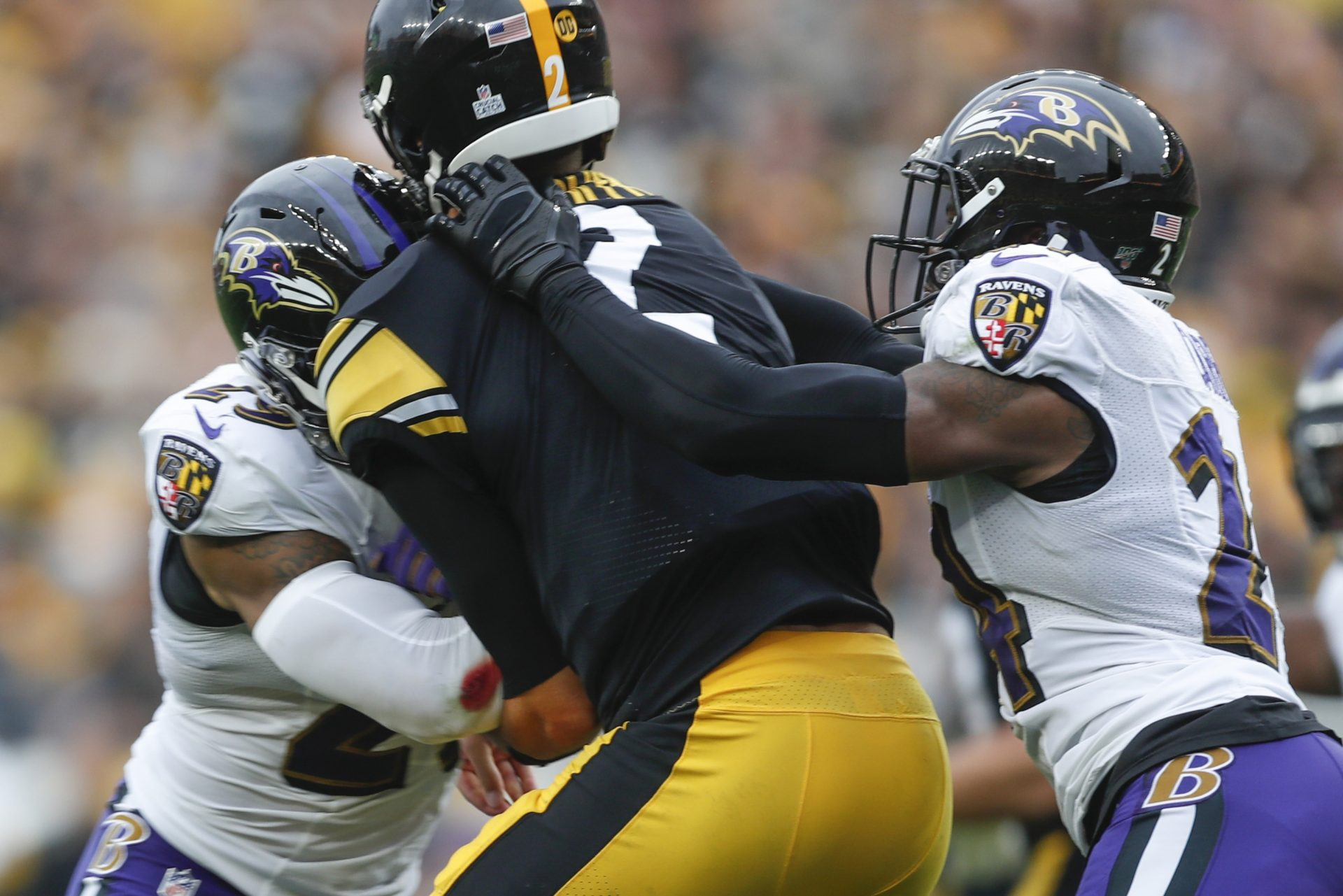 Pittsburgh Steelers quarterback Mason Rudolph (2) is hit by Baltimore Ravens free safety Earl Thomas (29), left, and cornerback Brandon Carr (24) during the second half of an NFL football game, Sunday, Oct. 6, 2019, in Pittsburgh.