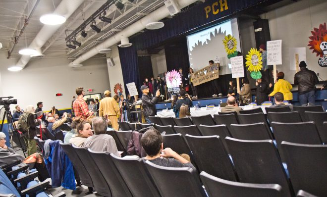 Members of the environmental group Philly Thrive took over a meeting about the legacy of clean-up at the PES Refinery.