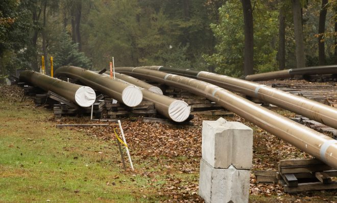 In this Tuesday, Oct. 22, 2019 photo, pipes lay along a construction site on the Mariner East pipeline in a residential neighborhood in Exton, Pa.