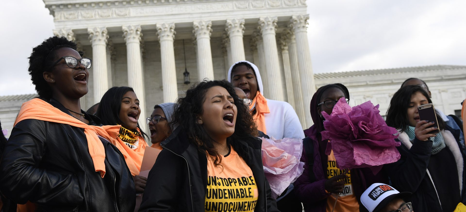 People protest outside the Supreme Court in Washington, Friday, Nov. 8, 2019. The Supreme Court on Tuesday takes up the Trump administration's plan to end legal protections that shield nearly 700,000 immigrants from deportation, in a case with strong political overtones amid the 2020 presidential election campaign.