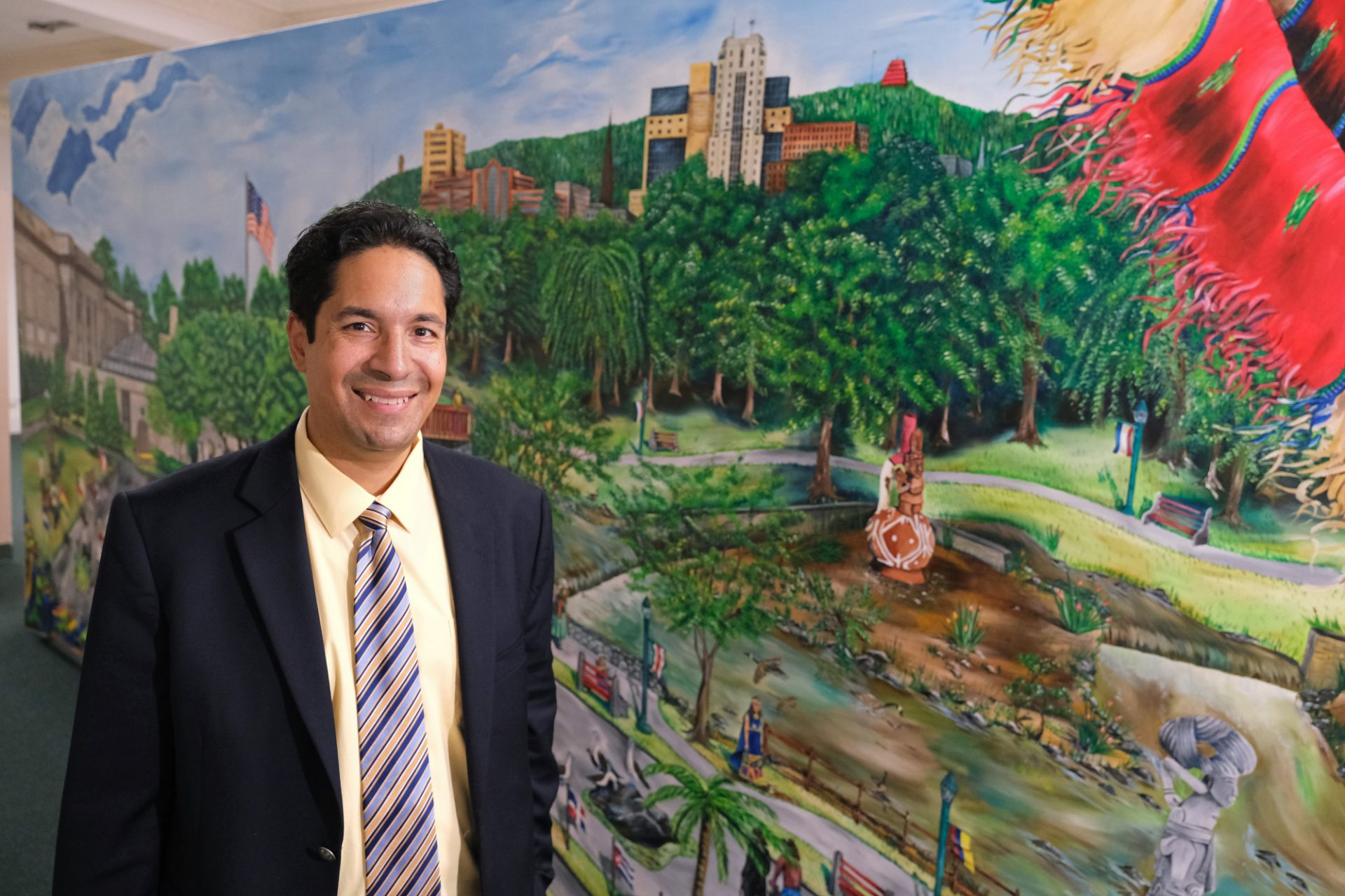 Centro Hispano Executive Director Mike Toledo stands near a mural of Reading on Oct. 31, 2019, while at the center on 5th Street in Reading, Pennsylvania.