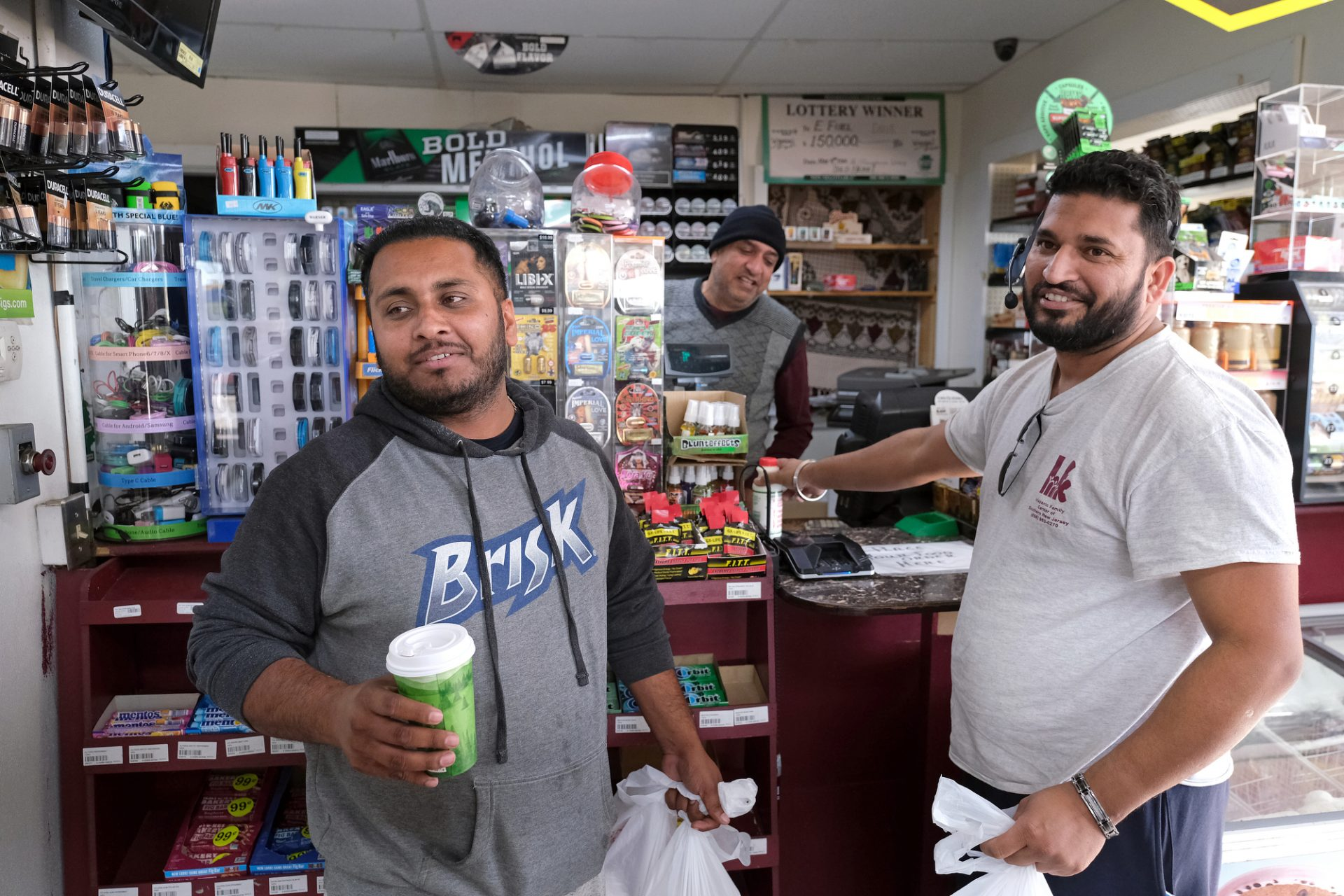 Sam Singh, left, of Michigan, and Arjan Singh, right, of New Jersey, buy food inside Eat Spice on Oct. 24, 2019, in the truck stop on route 534 off I-80 in White Haven, Pennsylvania. The restaurant caters to members of the Sikh community and as there is a large population of truckers from that community, the Indian Dhaba and Mediterranean dishes become hard to find on the road.