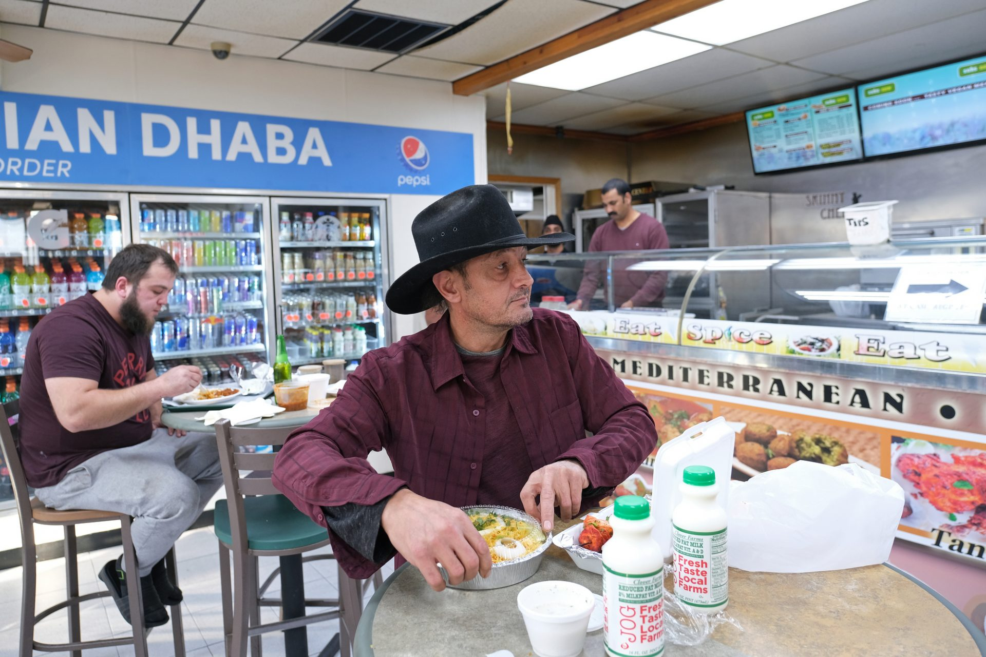 Sean Yazici, of Indiana, opens his food while inside Eat Spice on Oct. 24, 2019, in the truck stop on route 534 off I-80 in White Haven, Pennsylvania. The restaurant caters to members of the Sikh community and as there is a large population of truckers from that community, the Indian Dhaba and Mediterranean dishes become hard to find on the road.