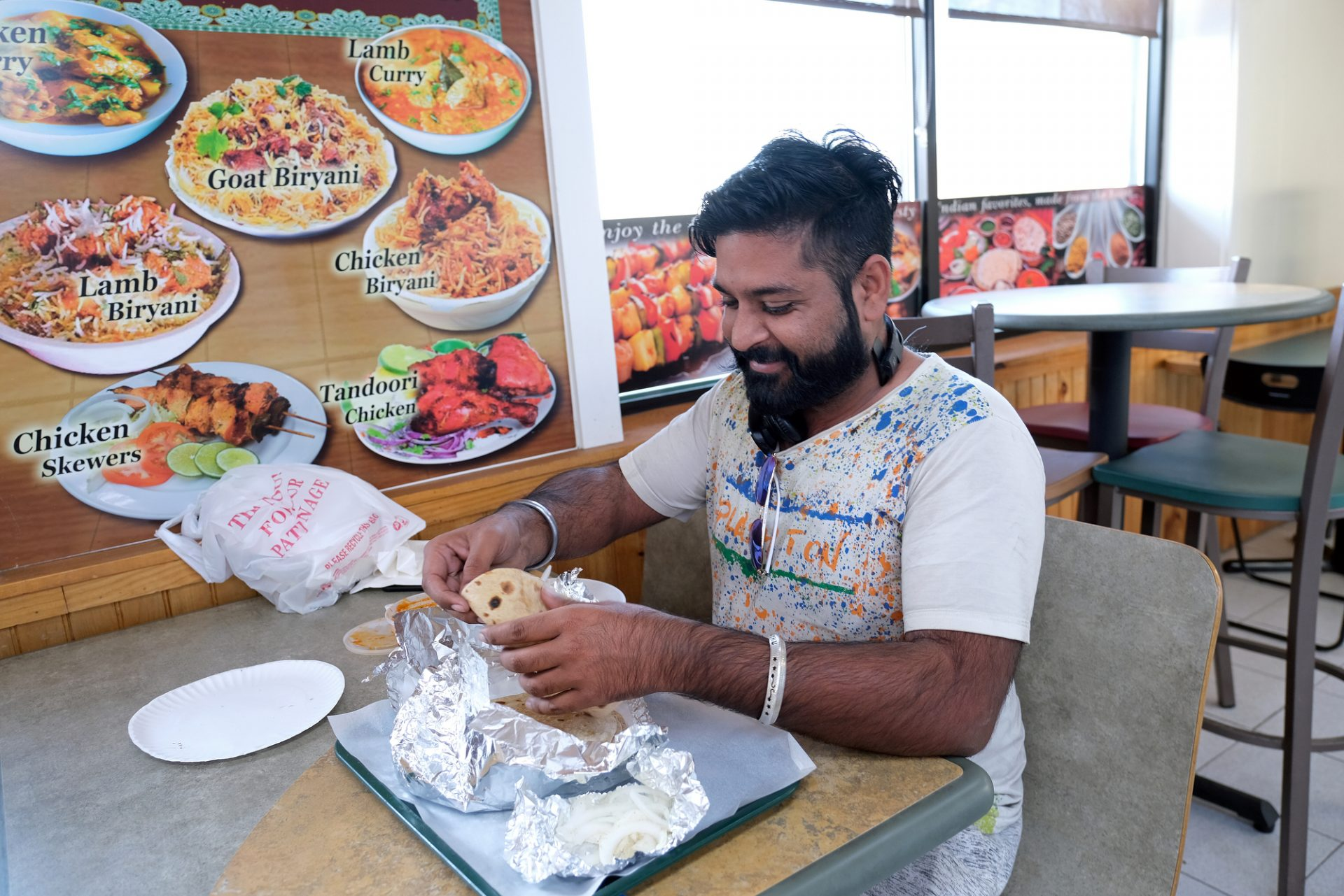 Aman Singh, of Indiana, talks while eating a meal at Eat Spice on Oct. 24, 2019, in the truck stop on route 534 off I-80 in White Haven, Pennsylvania. The restaurant caters to members of the Sikh community and as there is a large population of truckers from that community, the Indian Dhaba and Mediterranean dishes become hard to find on the road.