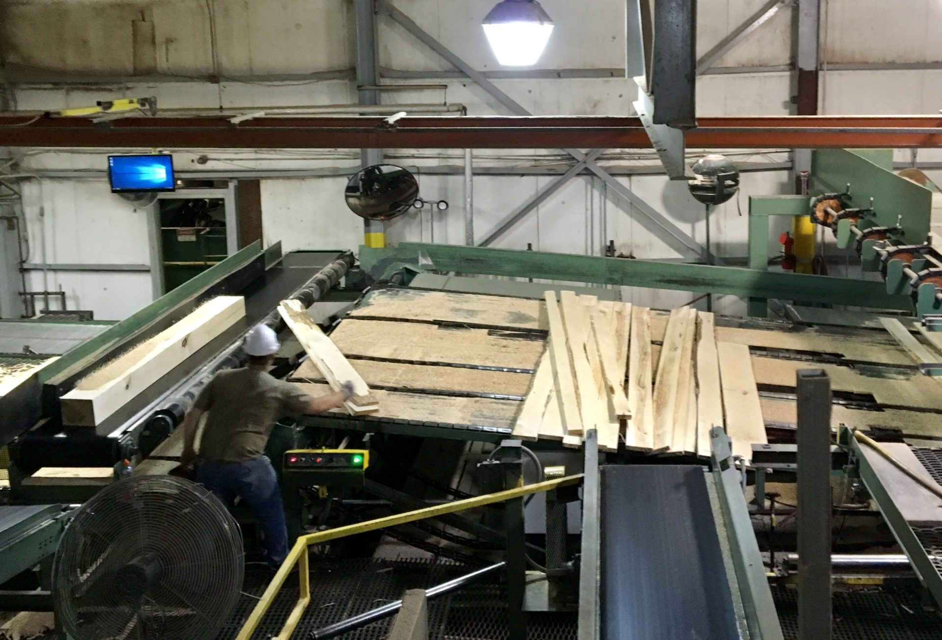 An employee at Collins Hardwood in Kane, Pennsylvania. The uncertainty of trade between China and the United States makes doing business in the hardwood industry more challenging.