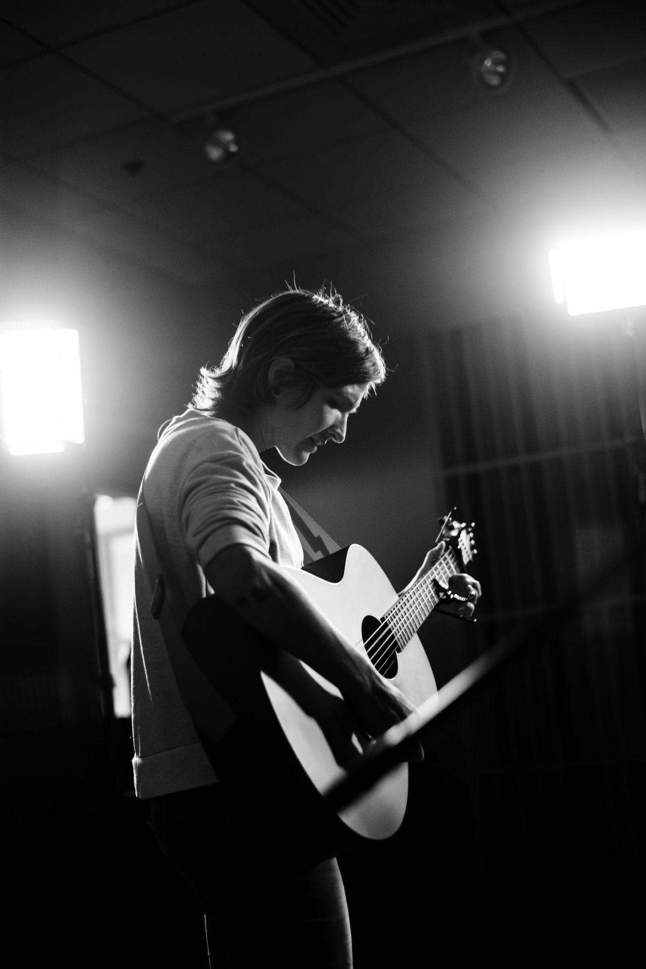 Sarah Fiore playing guitar