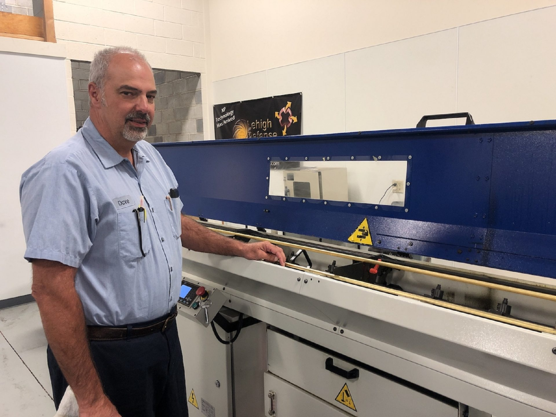 David Fricke of Quakertown, Pa.-based Millennium Manufacturing and Lehigh Defense with one of the machines used to make non-lead ammunition. Fricke says machining techniques makes it possible to avoid using lead, 'a proven hazard.'